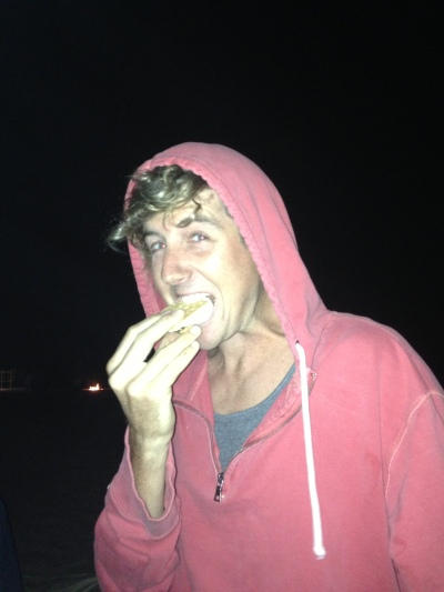 Keith crushing s'mores at the bonfire at Moonlight!